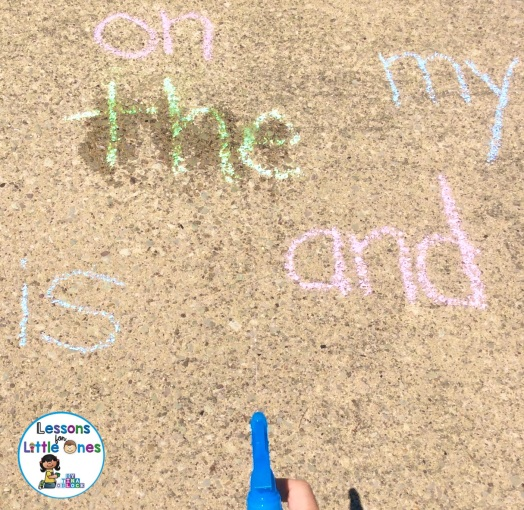 squirting water sidewalk chalk sight words learning activity