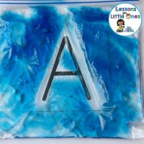 practicing letters of the alphabet with gel bags