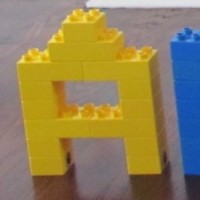 build letters of the alphabet with Legos or blocks